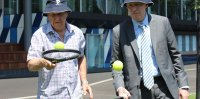 Australian Open meteorologist Bob Leighton (L) and tournament director Craig Tiley at Melbourne Park; Tennis Australia
