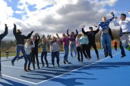Both teams jump for joy on the new and beautiful blue tennis courts recently open for play on the Mt. Blue Campus.