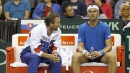 Slovakia Davis Cup Captain Miloslav Mecir, left, talks with Norbert Gombos, during a break in play of the first set of a Davis Cup World Group playoff match against John Isner, of the United States, Friday, Sept. 12, 2014, at the Sears Centre Arena in Hoffman Estates, Ill
