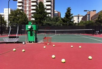 100 MPH tennis ball machine