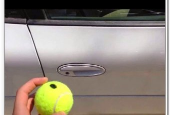 Car door tennis ball