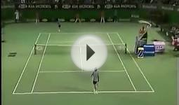 Exhausted tennis players give their racket to ball boys