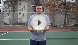 WIFE HITS CAMERA WITH TENNIS BALL